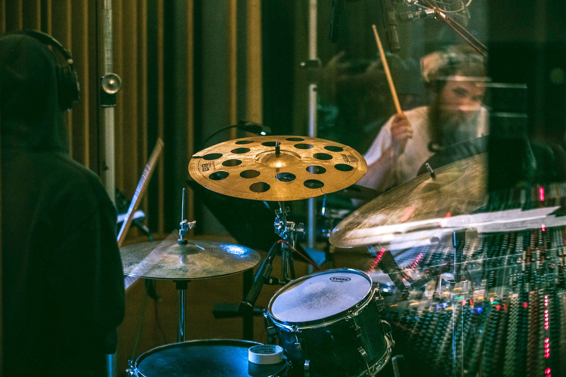 two students playing drums in a studio