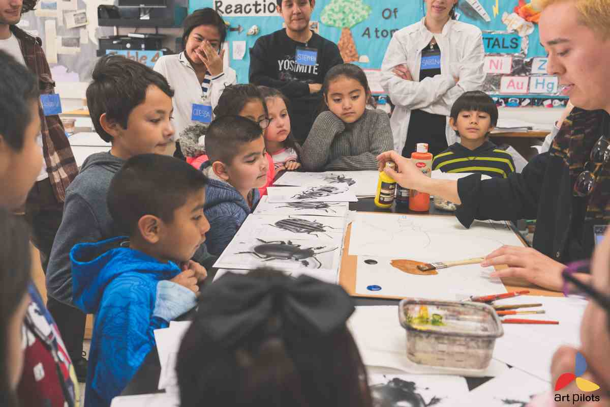 CAP Alumni Instructor teaches visual art to 2nd and 3rd graders at Newhall Elementary School in the Art Pilots Pedagogy Class